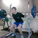Squat rack med vægtstang